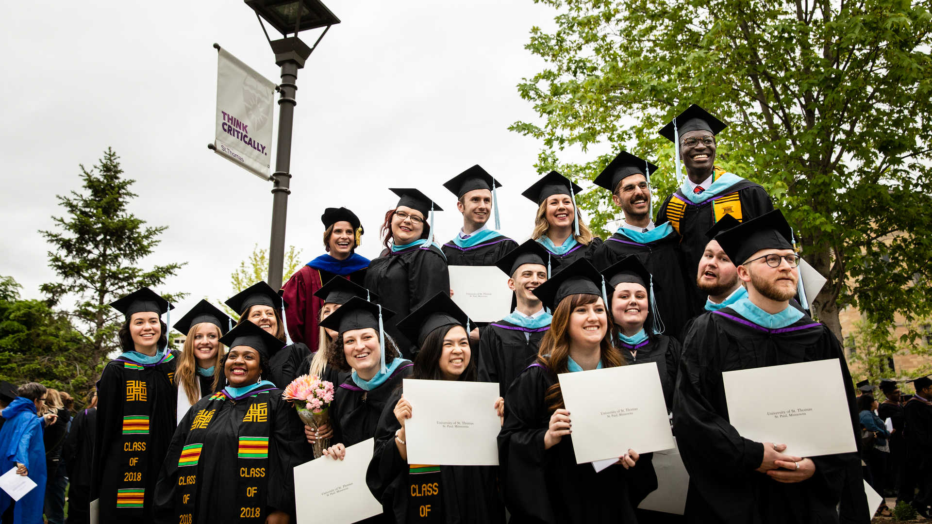 CELC graduates in group photo with diplomas